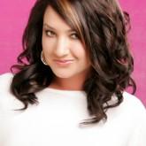 Волнистые волосы великолепно смотрятся при любом типе лица