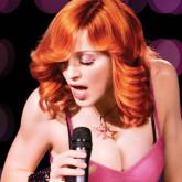 Ярко-рыжий оттенок волос Мадонны